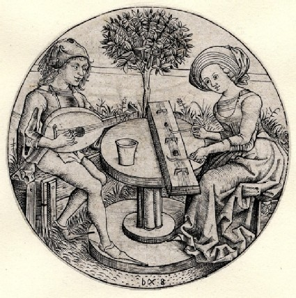 Couple making music in a garden