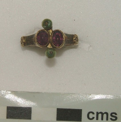 Ornamental ring with garnets and pearls