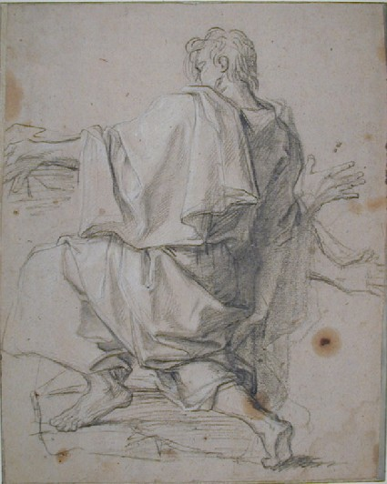 Man crouching, seen from behind, with arms outstretched