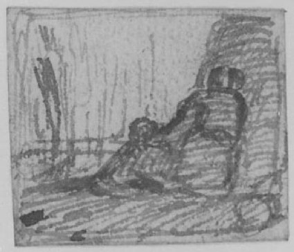 A woman seated against a tree