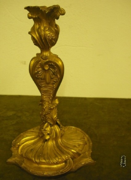Candlestick with scrolls and leaves