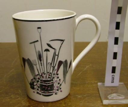 Mug, with black print,  'Garden Implements'