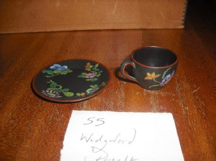 Miniature handled cup and saucer
