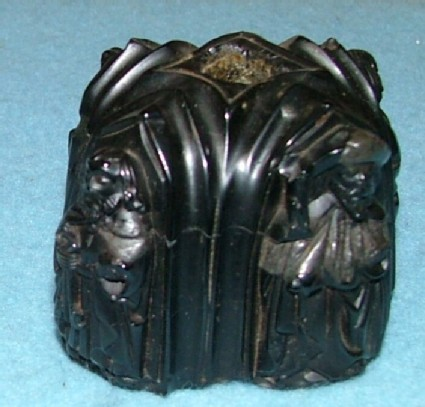 Knob or base decorated with SS James, John, Peter, and Paul