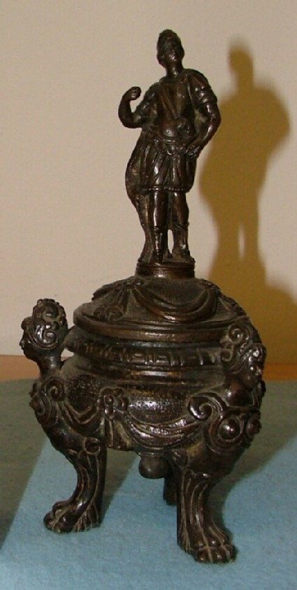 Inkstand supported by three helmeted sphinxes and crowned by a warrior