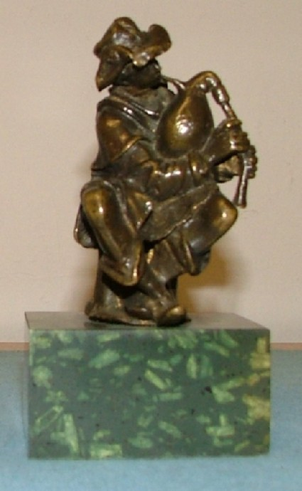 Seated peasant boy with bagpipes