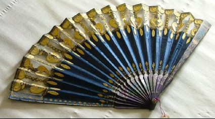 Folding fan of blue satin with capriccio-style landscape decoration