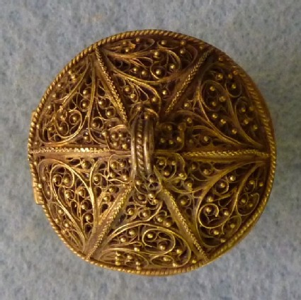 Gilt-brass verge watch in a garnet-set case contained in a silver filigree cup