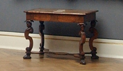 Writing table on scrolled legs