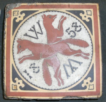 Tile with two foxes crossed with initial W repeated top and bottom  and date 1858
