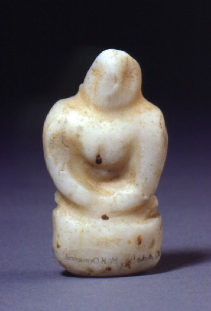 Seated female figurine with hands clasped below breast