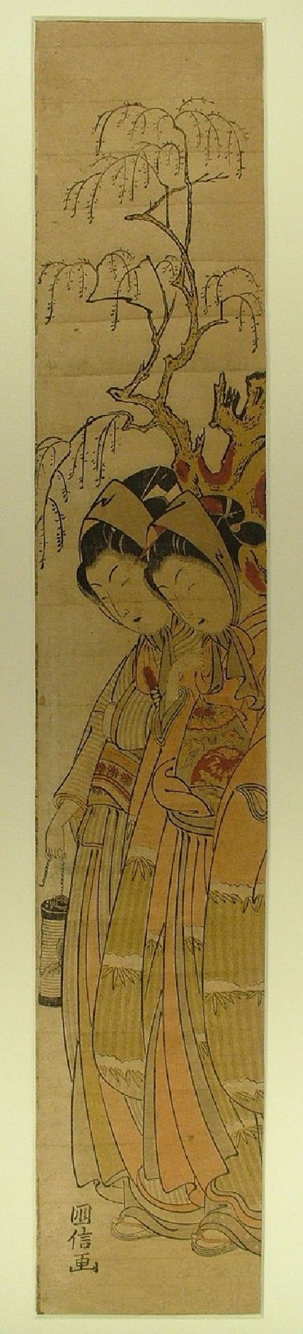Couple beneath a willow tree