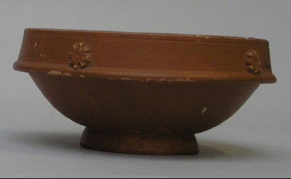 Red-slipped bowl with applied rosettes and stamped by Caius Murius