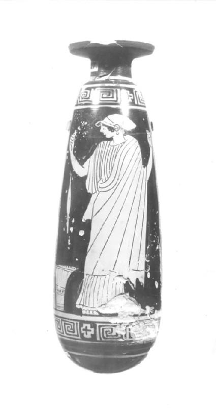 Attic red-figure pottery alabastron depicting a domestic scene