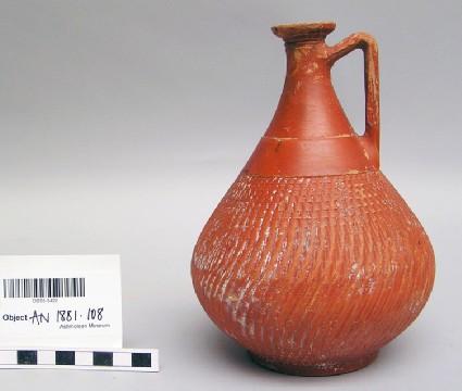 Roman or Samian Red Ware jug, ribbed decoration