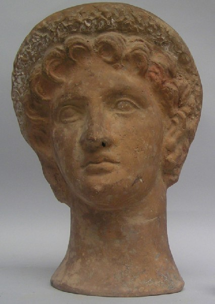 Terracotta head of youth wearing a wreath