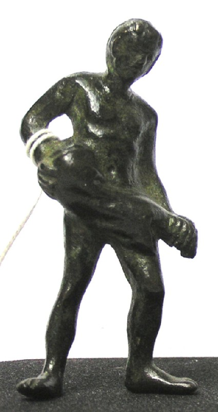 Bronze figure of a male carrying a wine skin