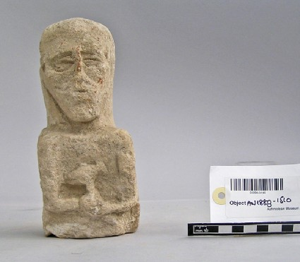 Limestone upper part of bearded votary, votive-figure