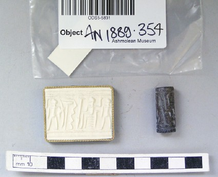 Steatite, cylinder seal with seated figure