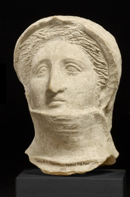 Head of veiled or shrouded female, fragment of funerary figure