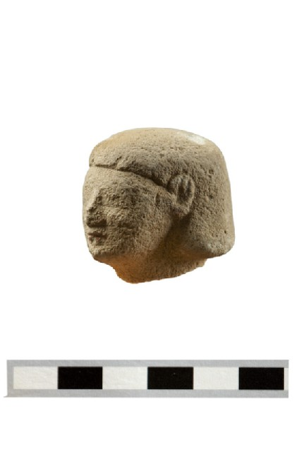 Head of fragmentary votive figure, male votary, Egyptianising style