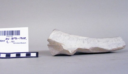 Fragment of marble basin with a Phoenician inscription on the rim
