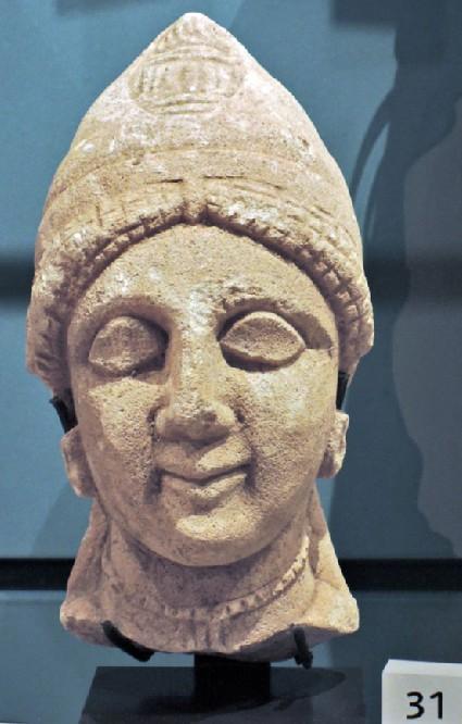 Limestone head of female votary, votive statuette