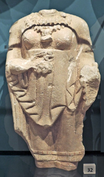 Limestone torso of female votary with Ionic mantle, Kore, votive statuette