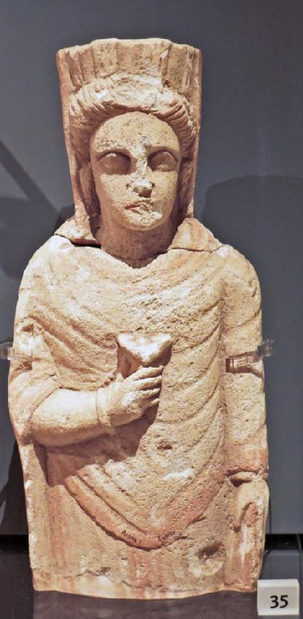Limestone statuette of a female (goddess) with turreted crown, votive statuette