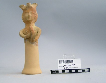 Female tambourine player figurine with Phoenician lamp on the head, lamp-stand