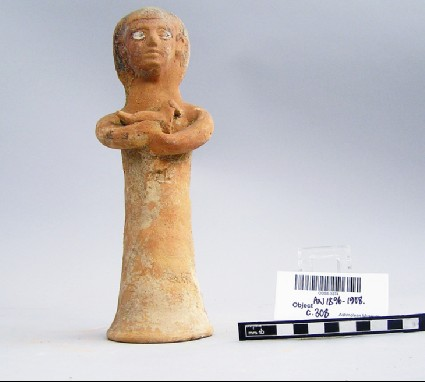Vortive figurine of a female offering bearer with bird