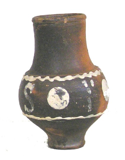 Dark Rhenish ware globular beaker with white barbotine decoration inscribed ZESI