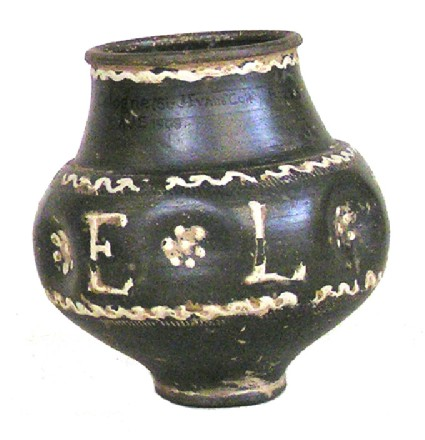 Black Rhenish ware indented beaker with white barbotine decoration inscribed FELIX
