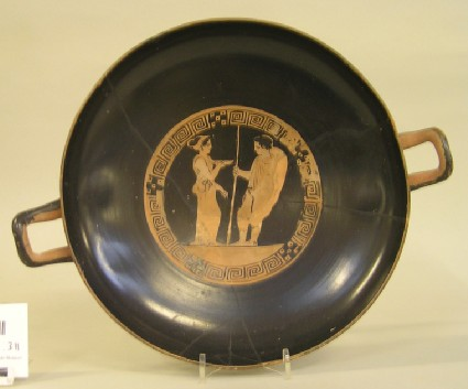 Attic red-figure stemmed pottery cup depicting a warrior scene
