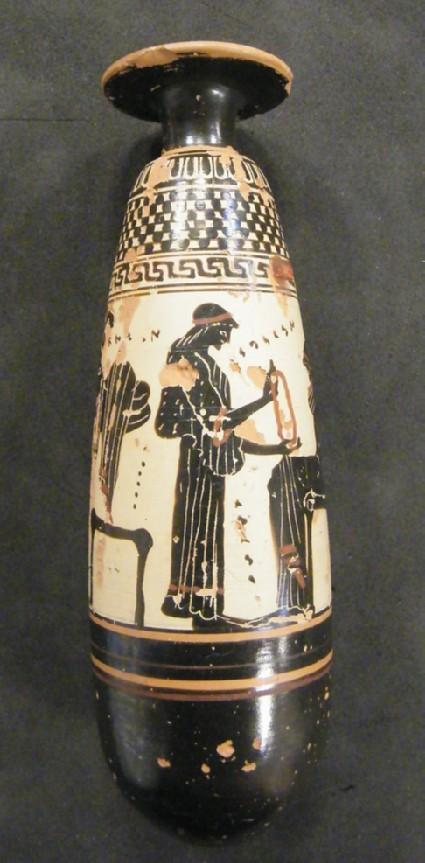 Attic black-figure white ground pottery unguent jar depicting a domestic scene