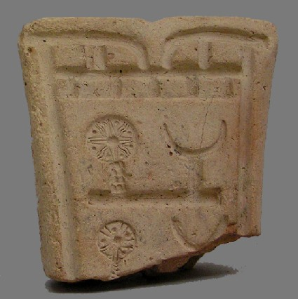 Fragmentary mould for casting a model chariot with solar and lunar symbols