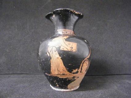 Attic red-figure pottery oinochoe depicting a domestic scene