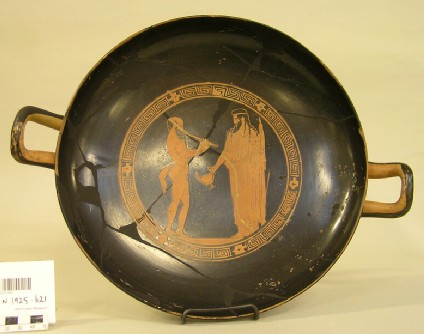 Attic red-figure stemmed pottery cup depicting a Dionysiac scene