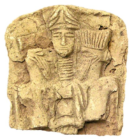 Upper part of a plaque with deity wearing a multiple horned crown, perhaps the goddess Ishtar
