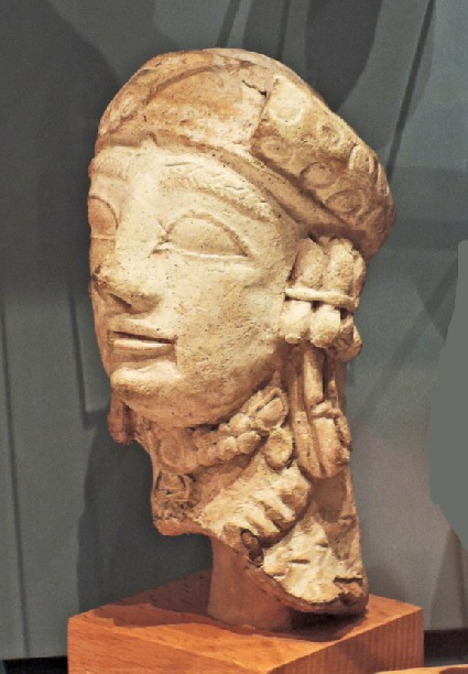 Terracotta head of female votary figurine with turban and rich jewellery
