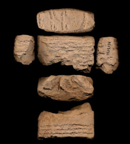 Clay tablet with inscribed cuneiform script