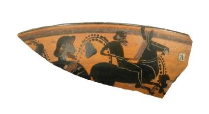 Attic black-figure stemmed cup sherd depicting a Dionysiac scene