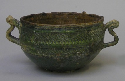 Green-glazed two-handled cup