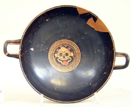 Attic black-figure pottery stemmed cup depicting a Dionysiac scene