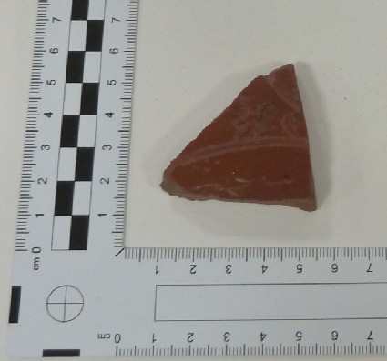 Sherd of Samian bowl with stem of winding scroll and a little bird