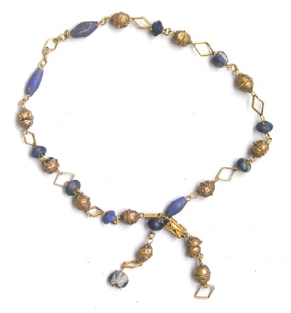 Child's gold necklace strung with lapis lazuli and glass