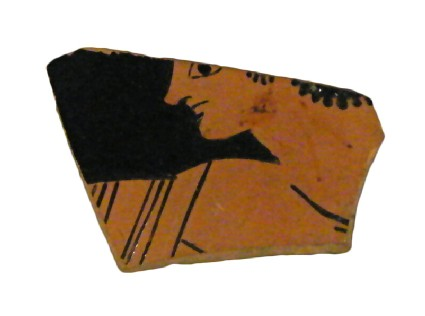 Attic red-figure pottery cup sherd depicting a scene of daily life
