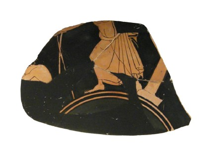 Attic red-figure pottery stemmed cup fragment depicting an athletics scene