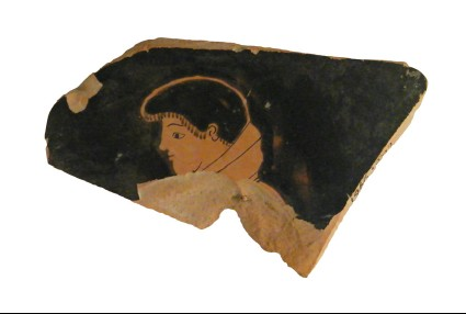 Attic red-figure pottery krater sherd depicting a male youth