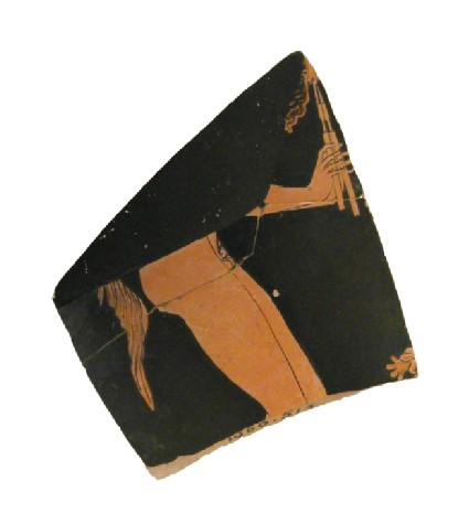 Attic red-figure pottery cup fragment depicting a Dionysiac scene